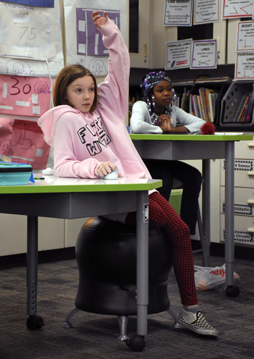 Ferndale Upper Elementary students sit at adjustable desks in flexible seating.