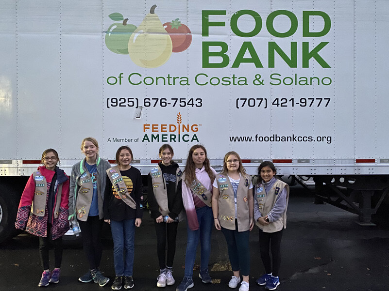 Page 17 of Girl Scout Troop Volunteers at the Food Bank