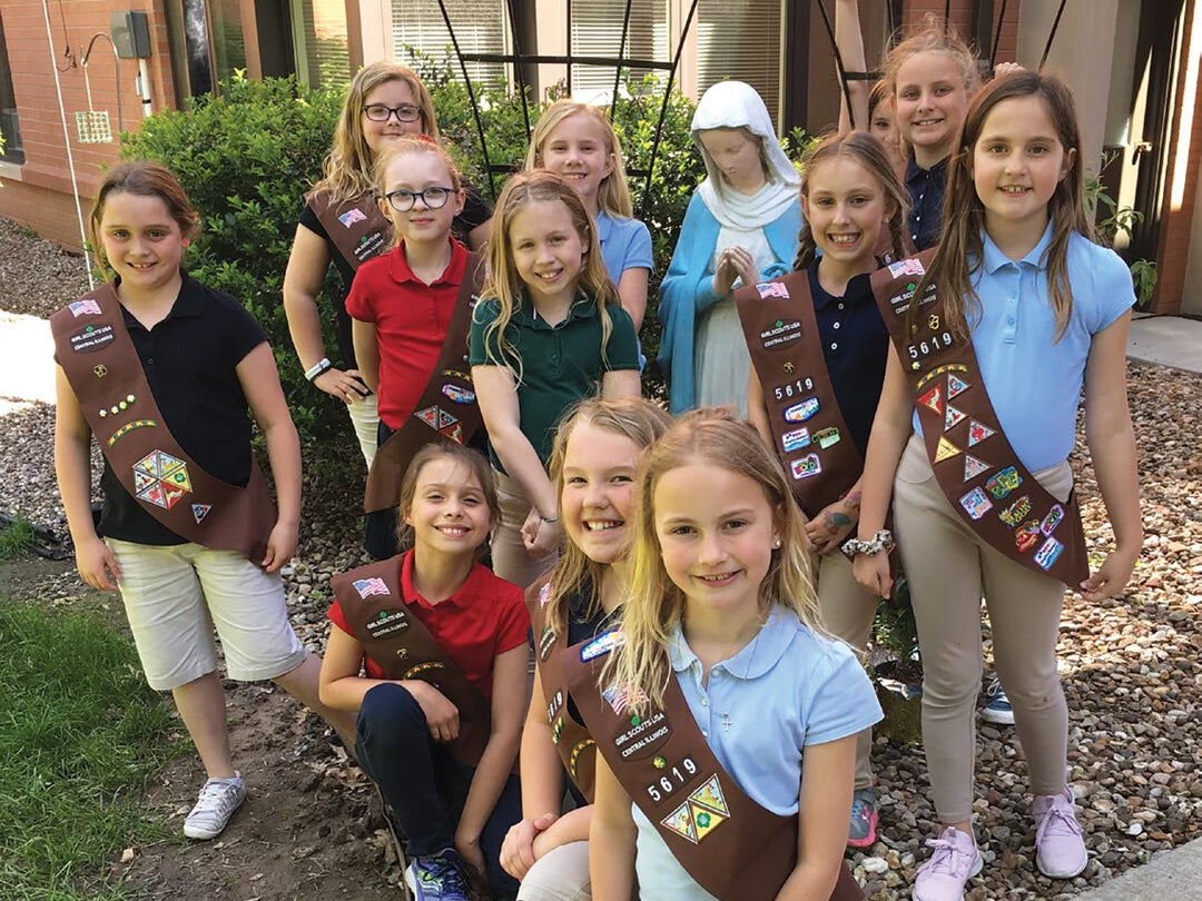 Page 4 of The Girl Scouts of St. Peter: Empowered for Service