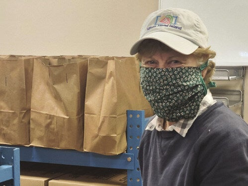 Page 1 of Catholic Charities Food Pantry Volunteers Serve As Christ To Those In Need